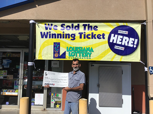 Ali Zadi, owner of Superior Discount, receives store's $20,000 lottery bonus