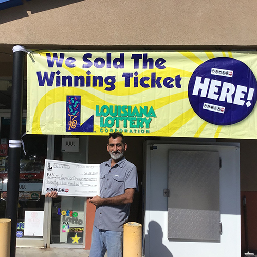 Ali Zadi, Superior Discount owner, poses with $20,000 lottery bonus check
