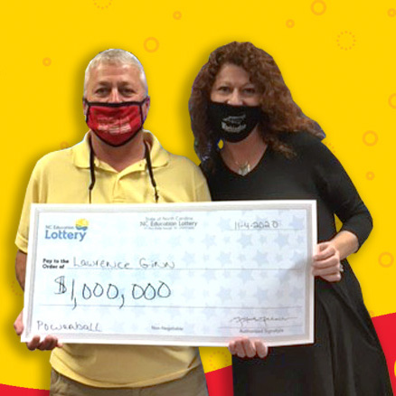"Lawrence Ginn and his wife with their 'Big Check"" for their $1 million win"