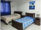 Img - Habitación con 2 camas individuales, baño privado