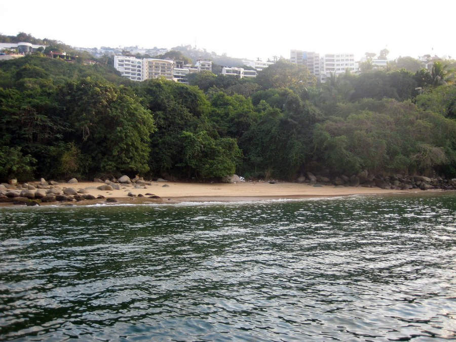 <p>Secreto Beach in Acapulco is surrounded by jungle</p>