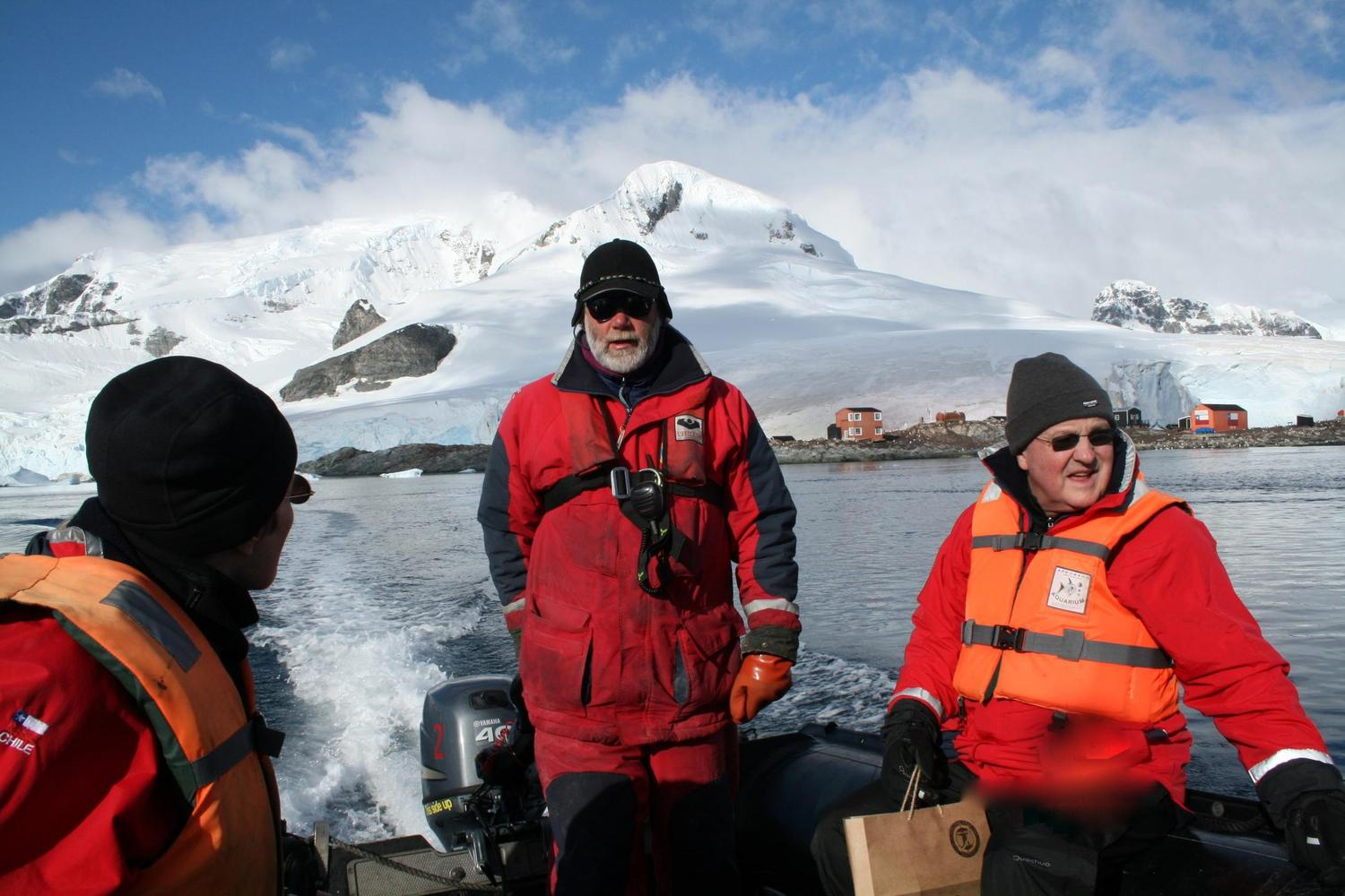 Zodiac captain leading group on shore in Antarctica