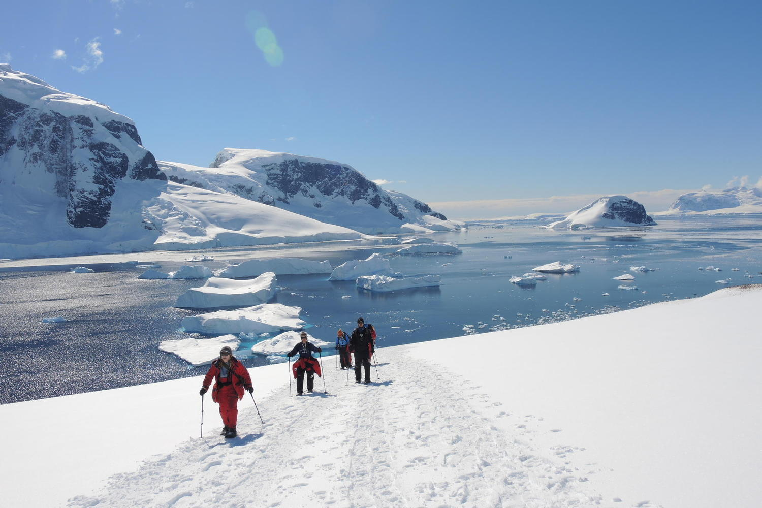 Snowshoeing up to the point on Danco Island on a sunny day