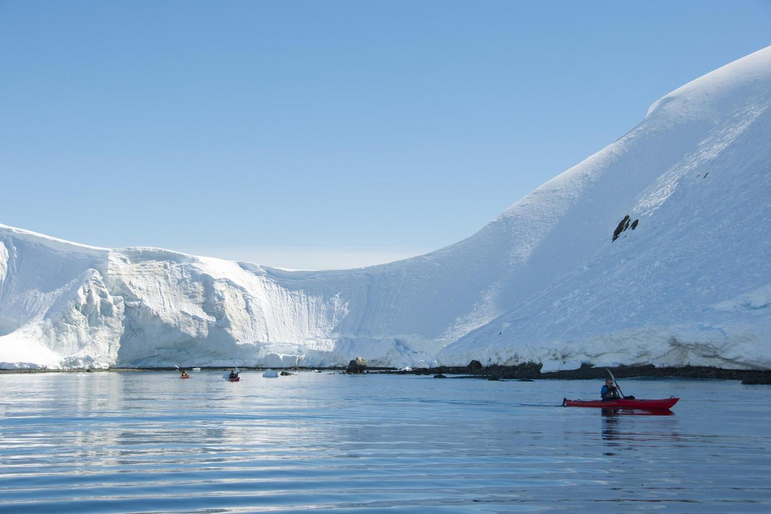 Kayaking calm waters off the Antarctic Peninsula