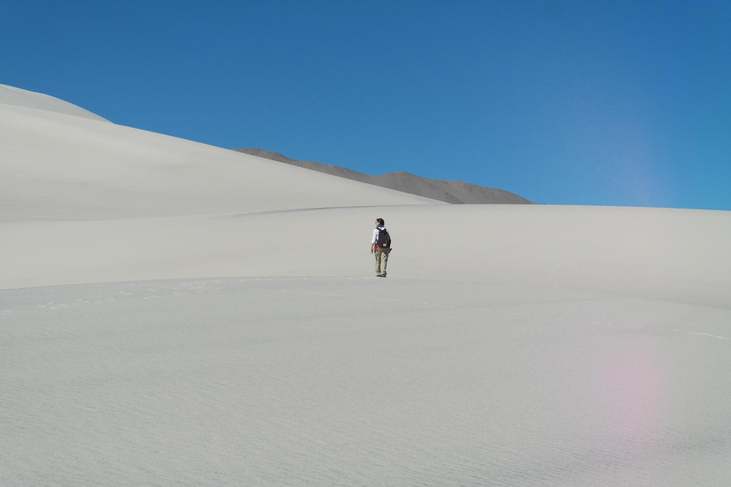 Walking across the sand dunes of the Puna, Argentina