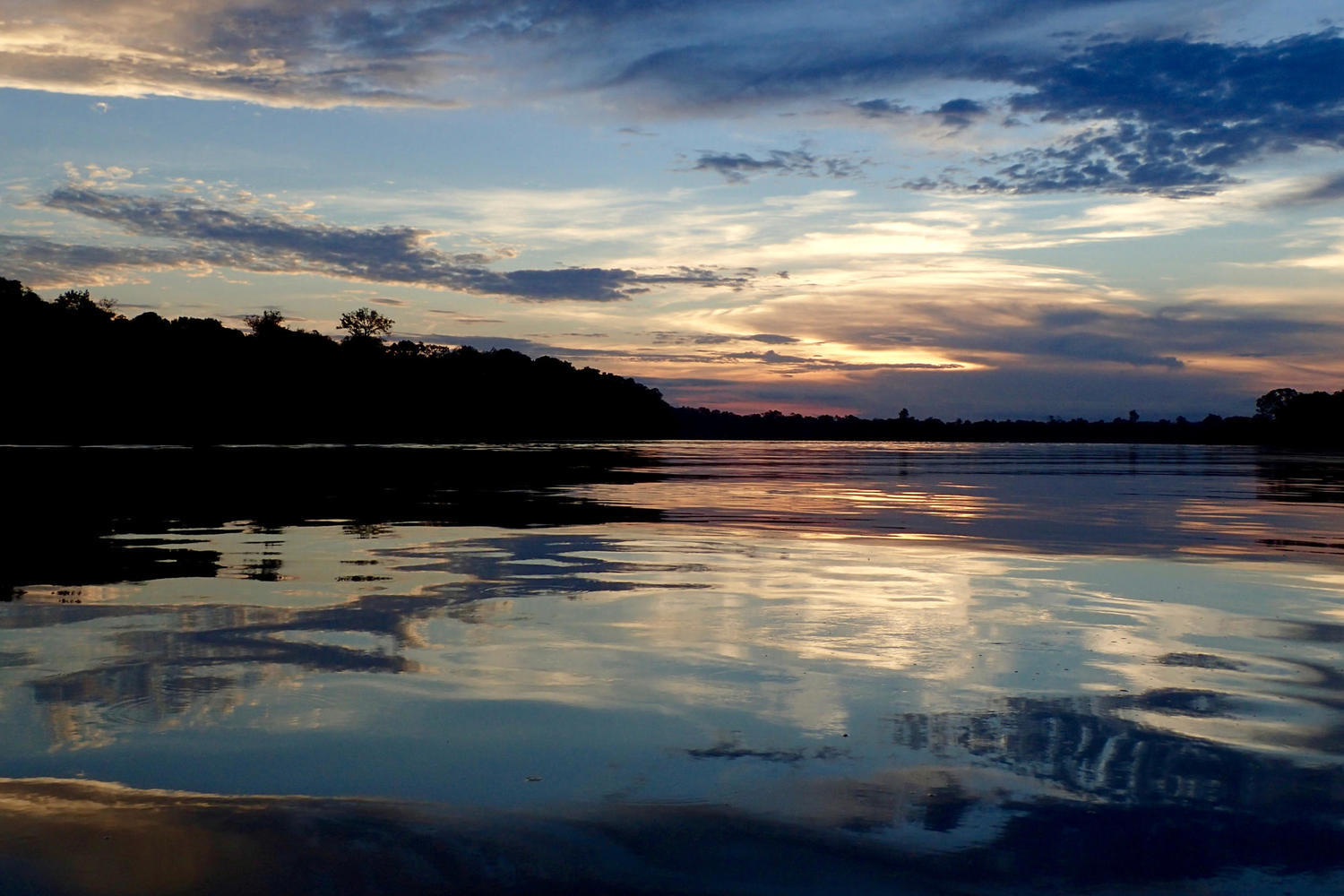 Sunset over the river in Cristalino Reserve, Amazon