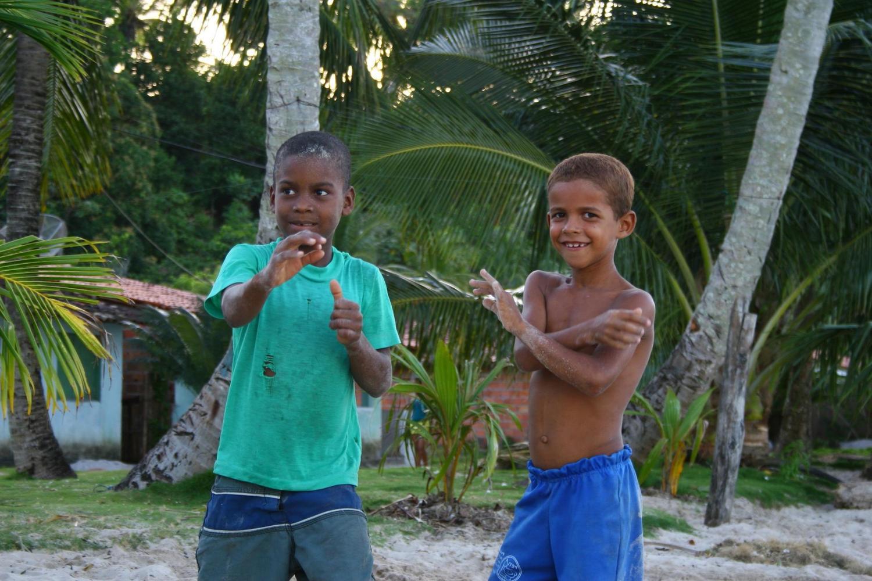 Boys on the beach of Boipeba island, Brazil