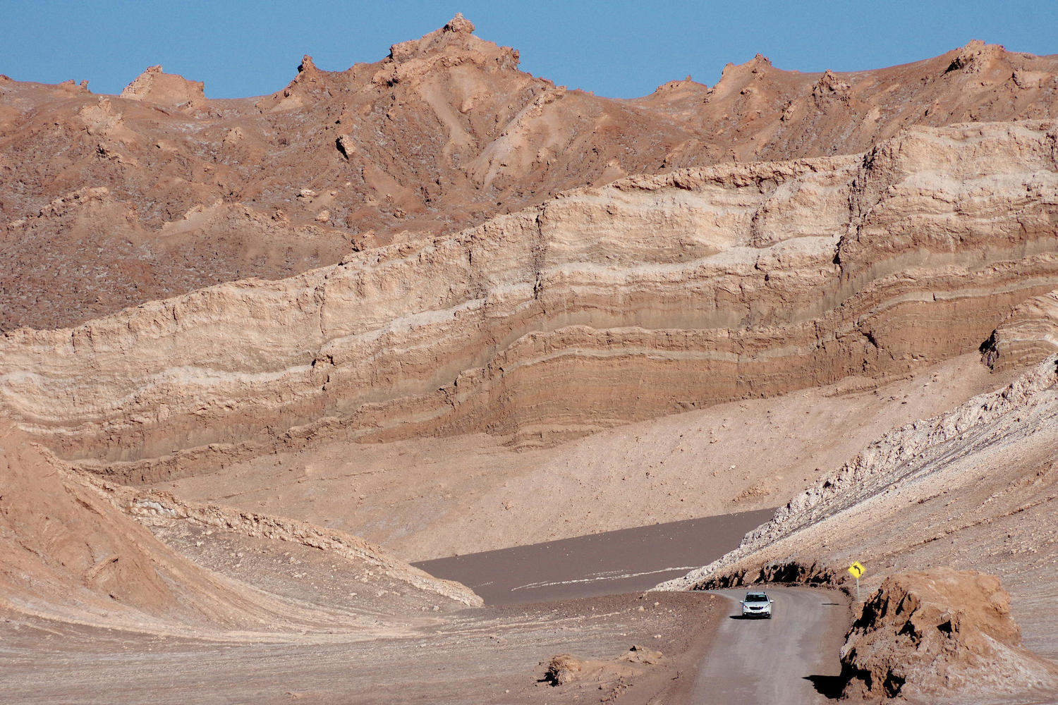 car driving in Moon Valley in Atacama Deser