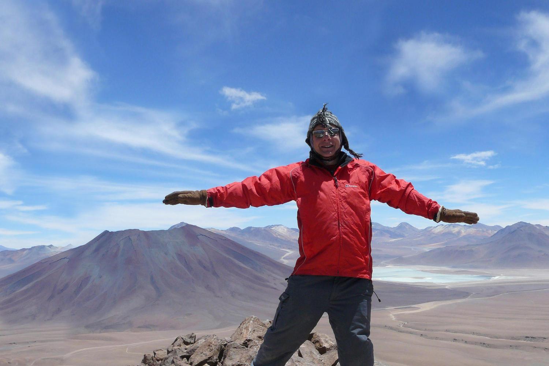 Standing high on top of Toco Volcano in the Atacama Desert
