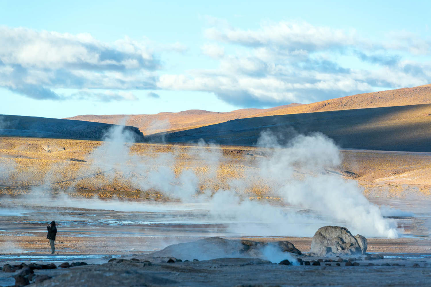 Steam rising out of the ground at El Tatio geyser