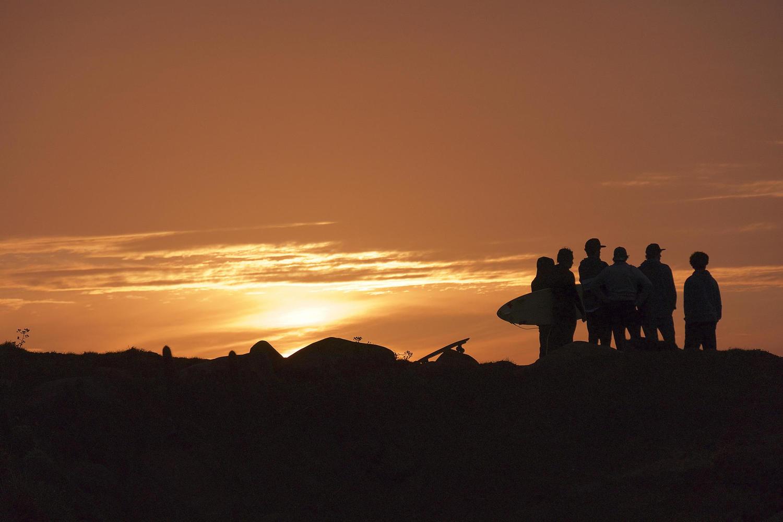 Surfers enjoying the sunset at Punta de Lobos, Pichilemu