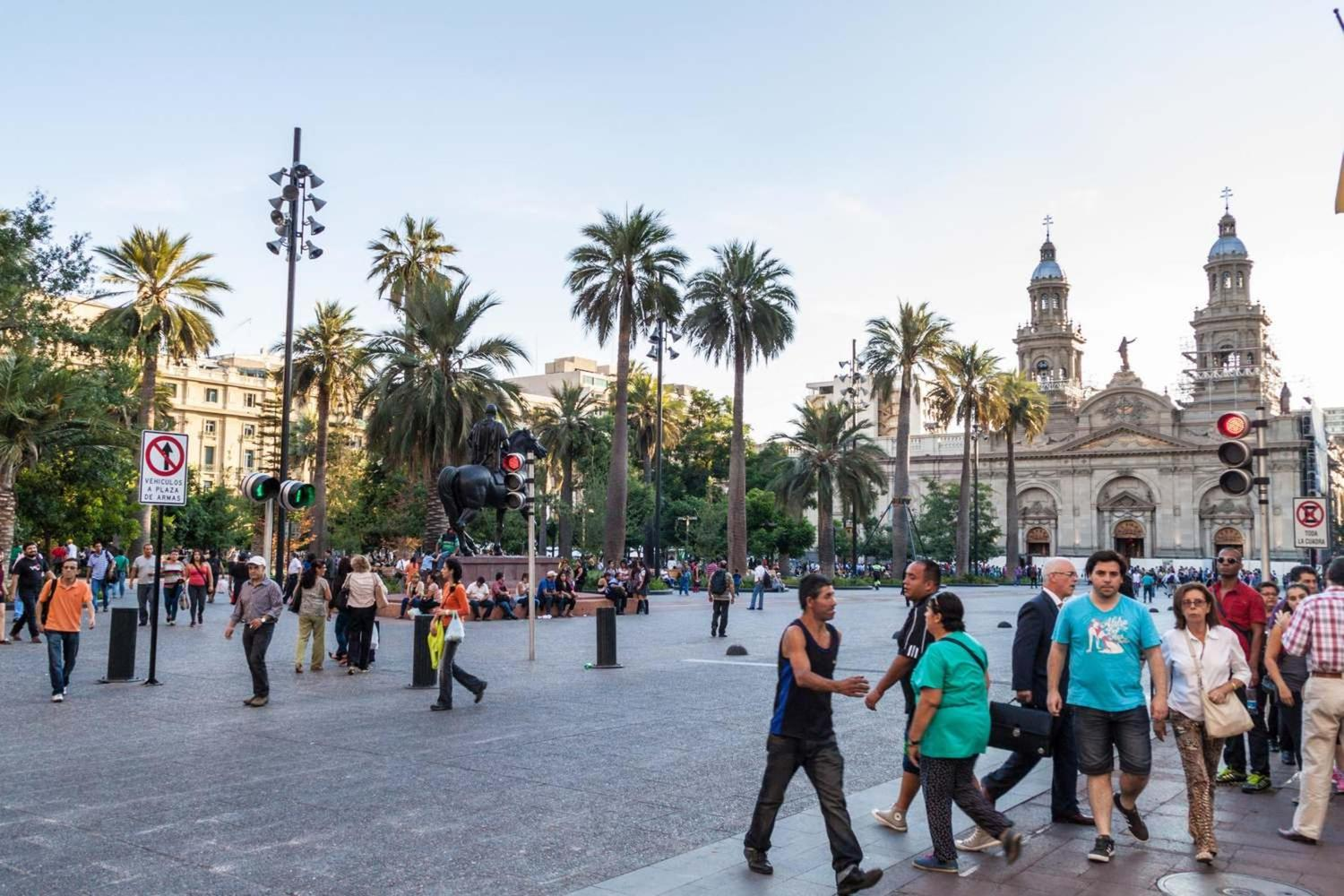 People walking at Santiago's Plaza de Armas