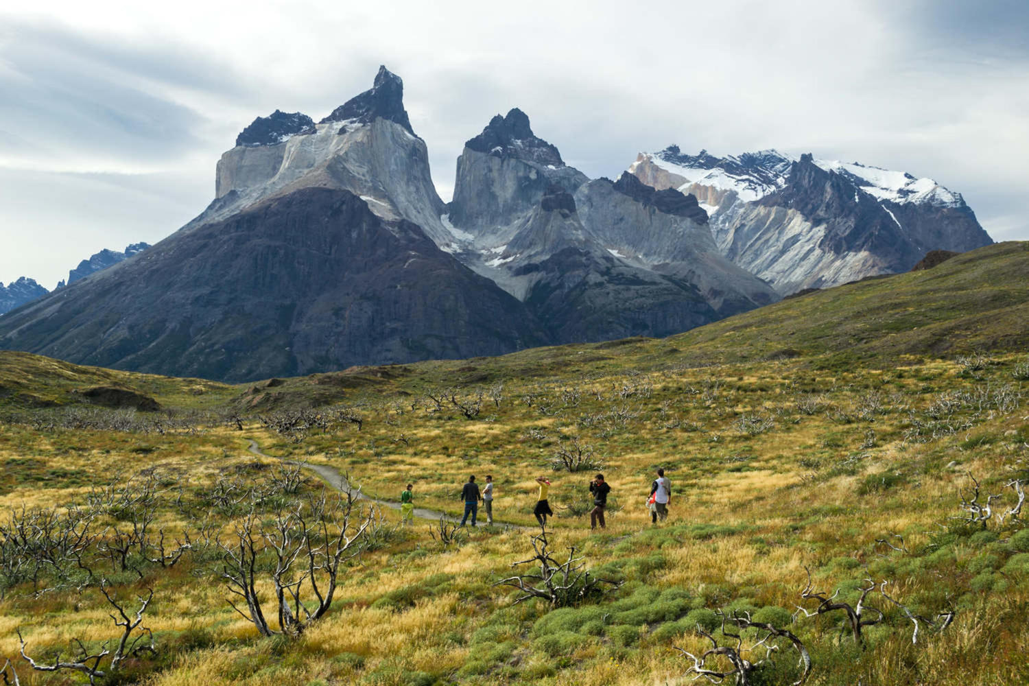 Hikers walking to Los Cuernos