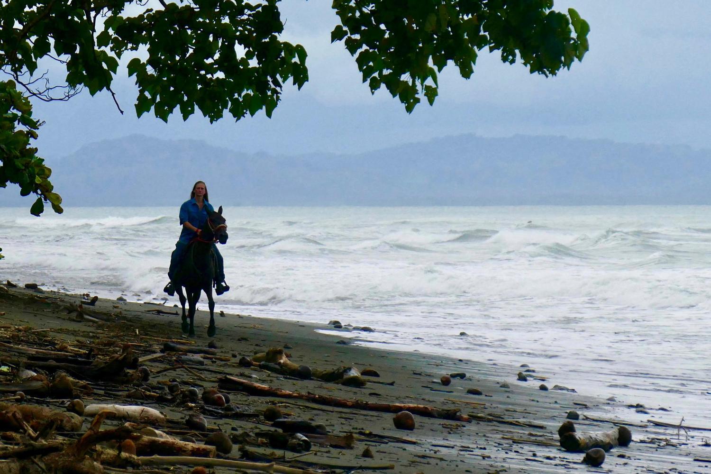 Horseback riding along the beach by the private beach house on Osa