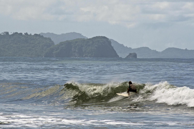Surfing off the beach of Punta Islita, Costa Rica