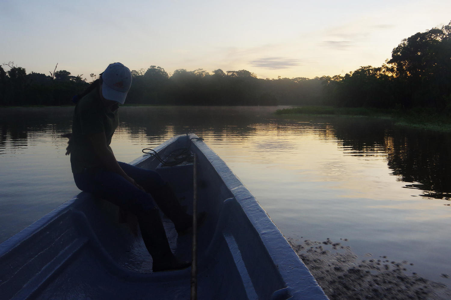 Rocio on canoe waiting to lead night paddle from Eden Lodge