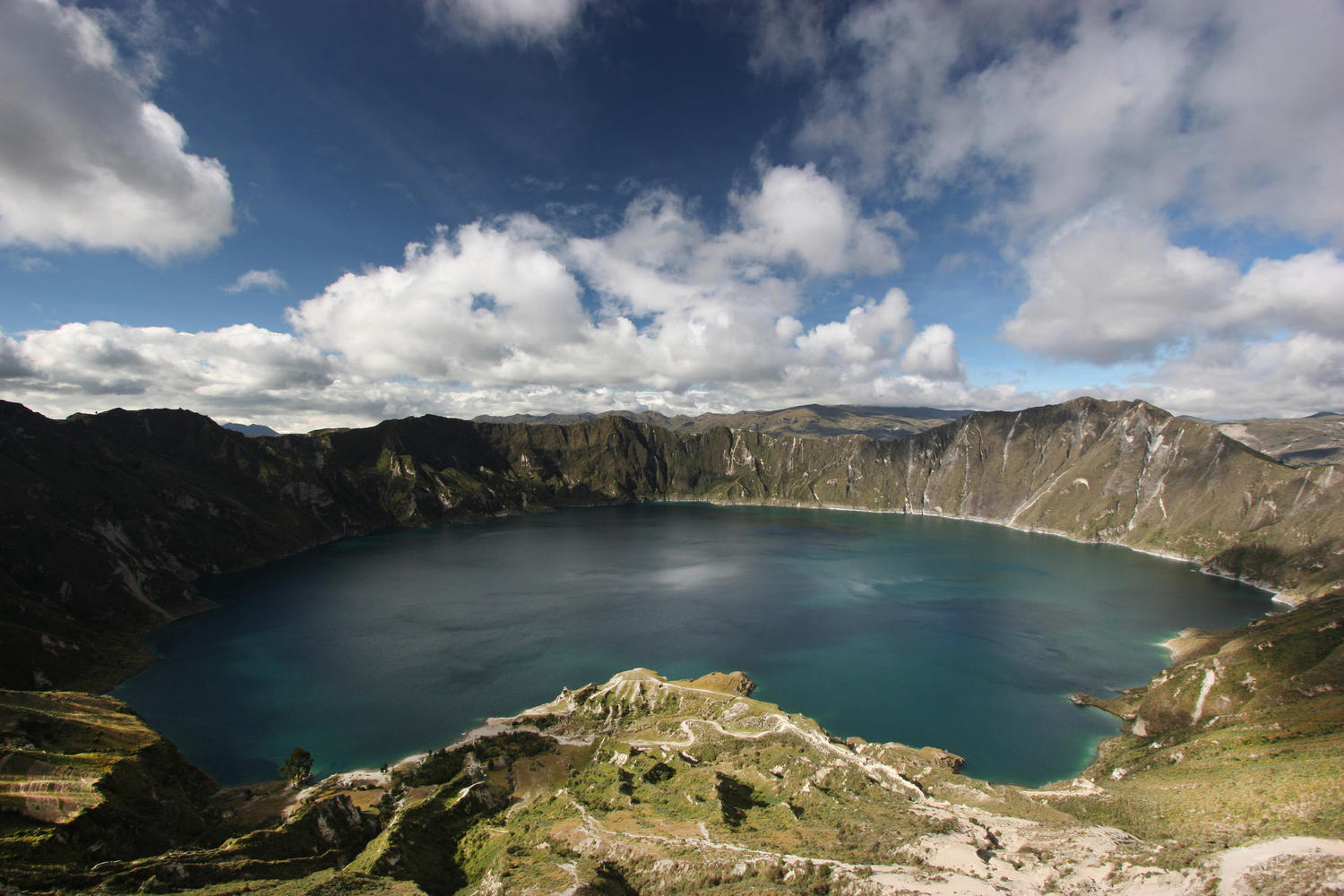 The beautiful blue waters of the Quilotoa crater lake in Ecuador