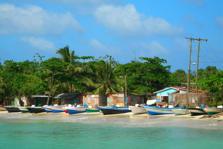 Native panga fishing boats on beach with native zinc houses in Nicaragua's Corn island