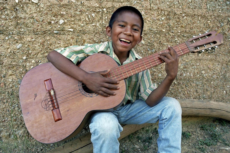 Boy singing with guitar in Managua, Nicaragua