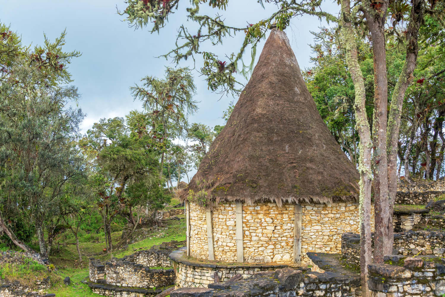 Ancient house with a thatch roof in the ruins of Kuelap