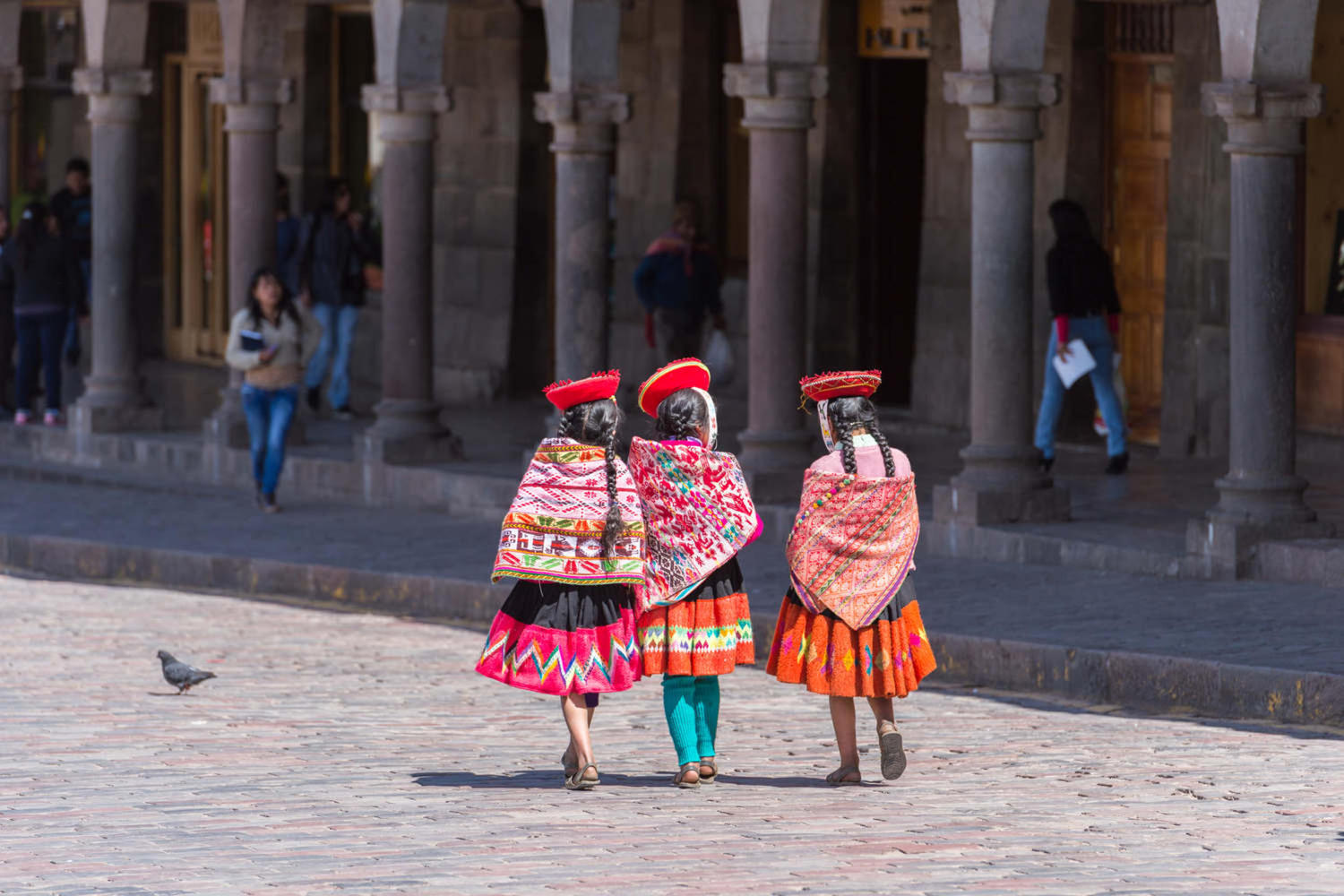 Peruvians wearing traditional clothes on a parade at Cusco's Plaza de Armas
