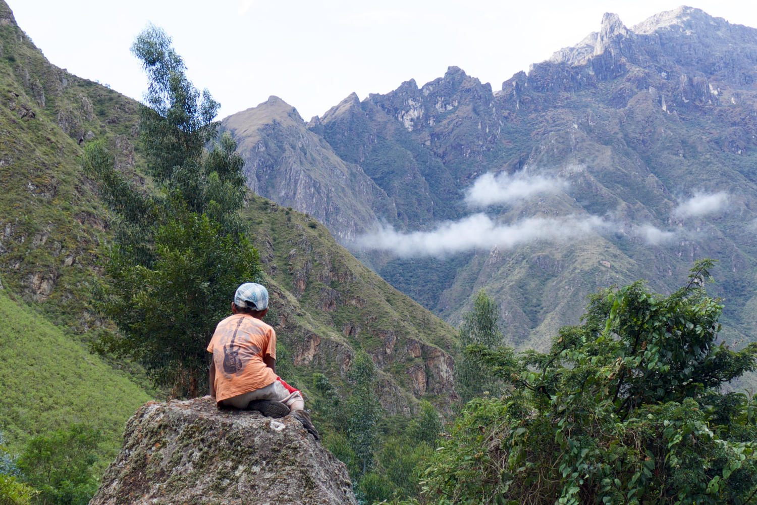 A local boy contemplates the views near our campsite on Day 1 of the Inca Trail