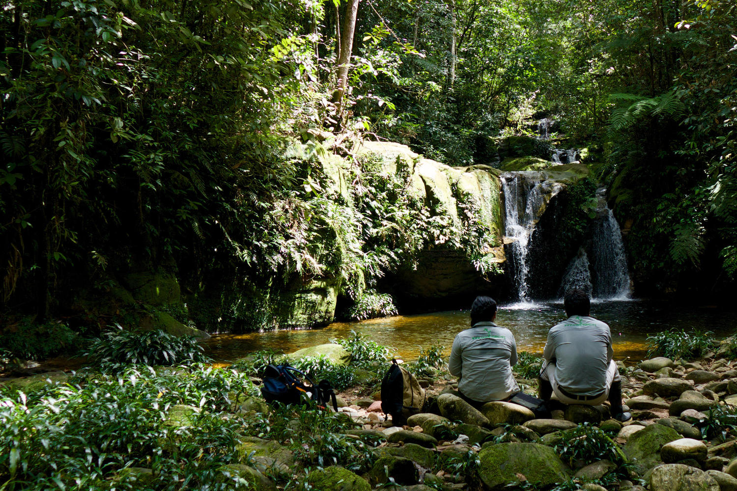 Taking a break at a waterfall in the Manu rainforest