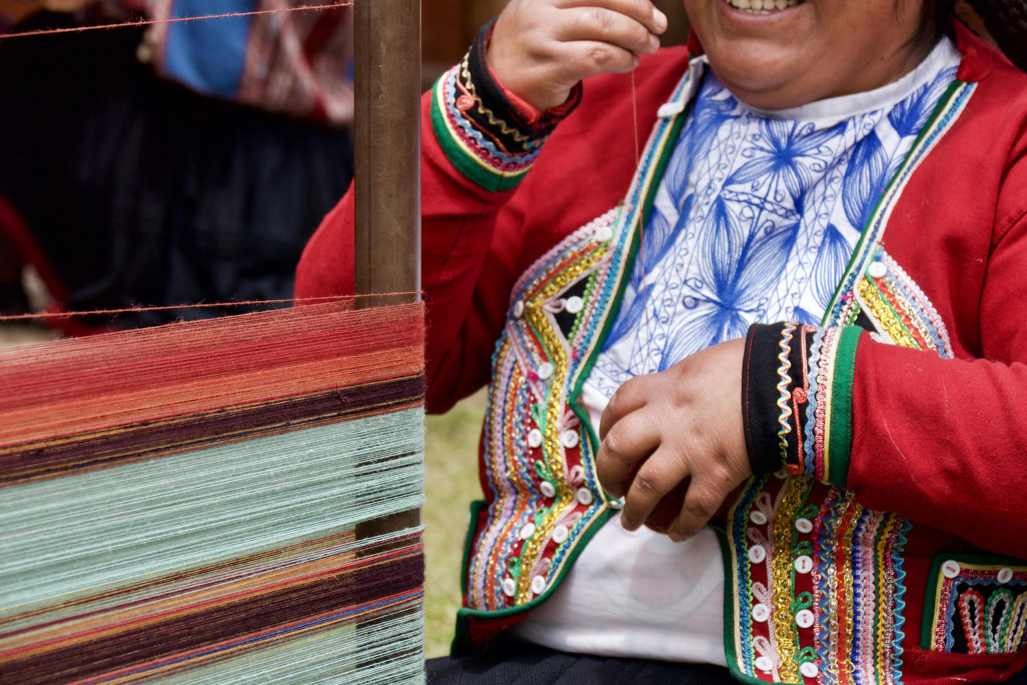 Working the traditional loom in the Sacred Valley.jpg