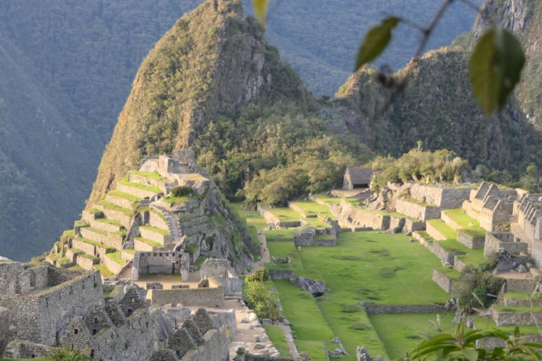 An empty Machu Picchu bathed in golden sunlight