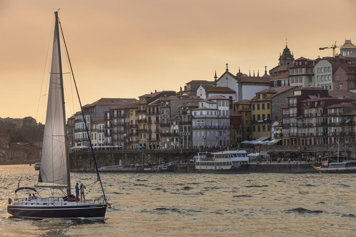 A rabelo sailing at sunset on the Douro in Porto