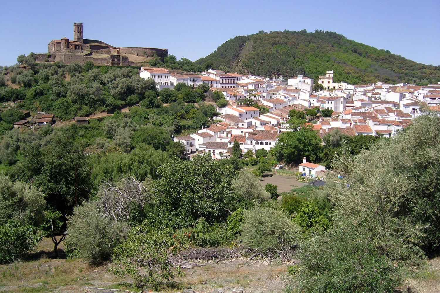 Almonaster with its church, white washed houses and bull ring