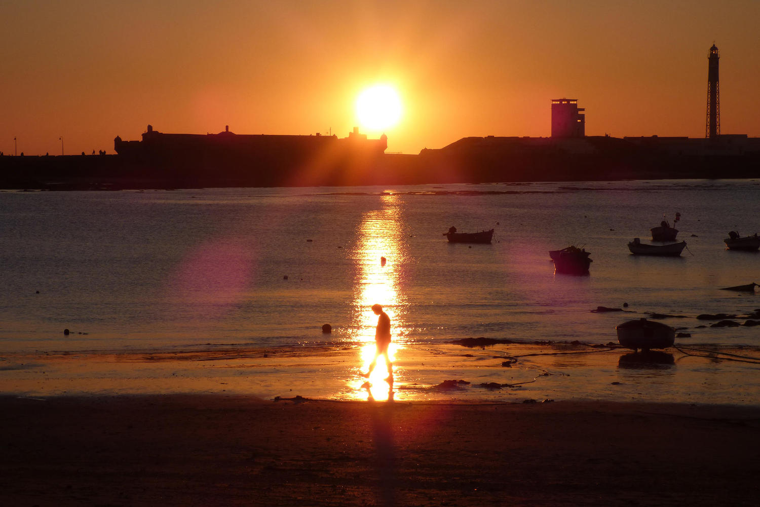 Sunset in La Caleta beach in Cadiz
