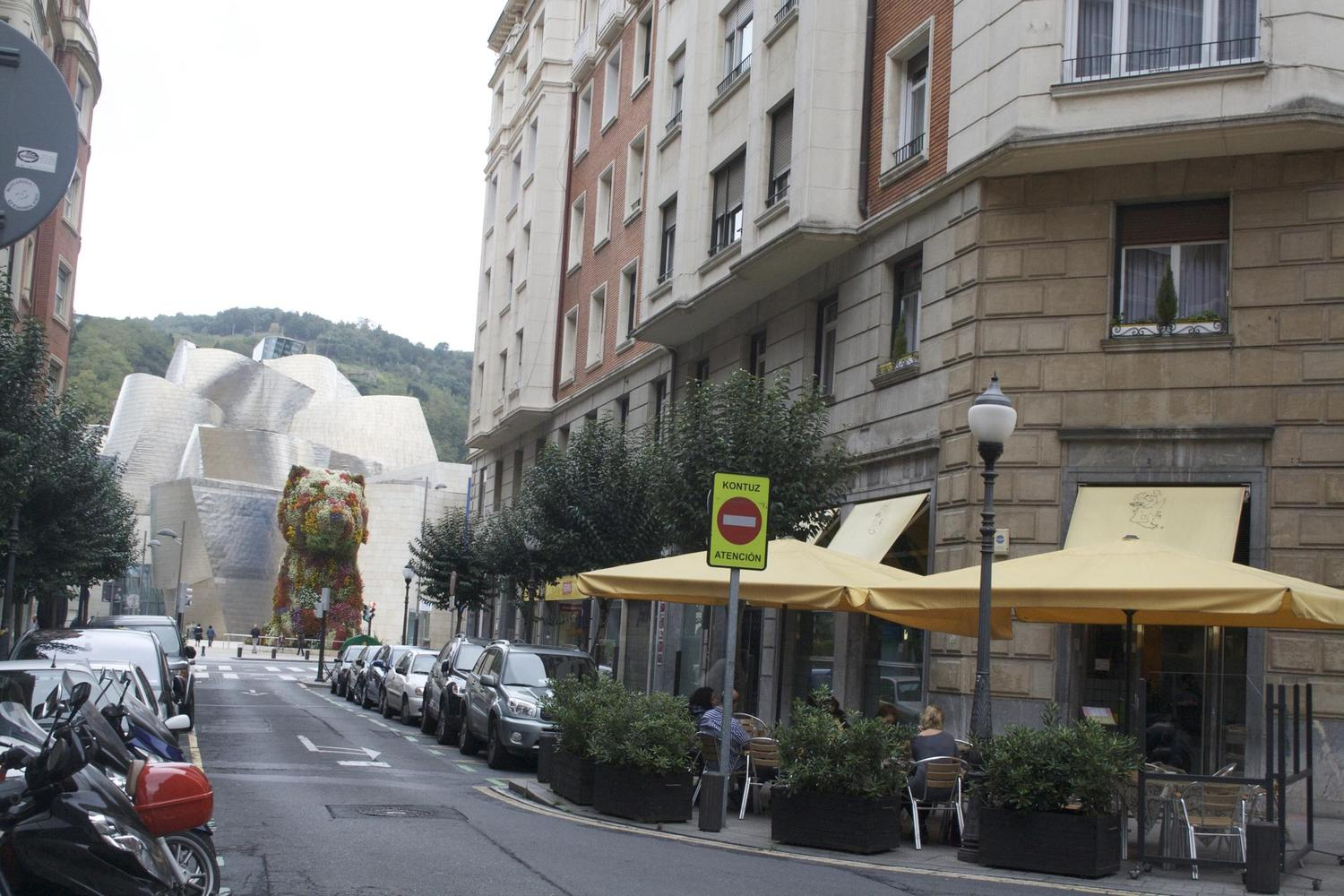 The Guggenheim museum ambushes you from Bilbao's traditional streets