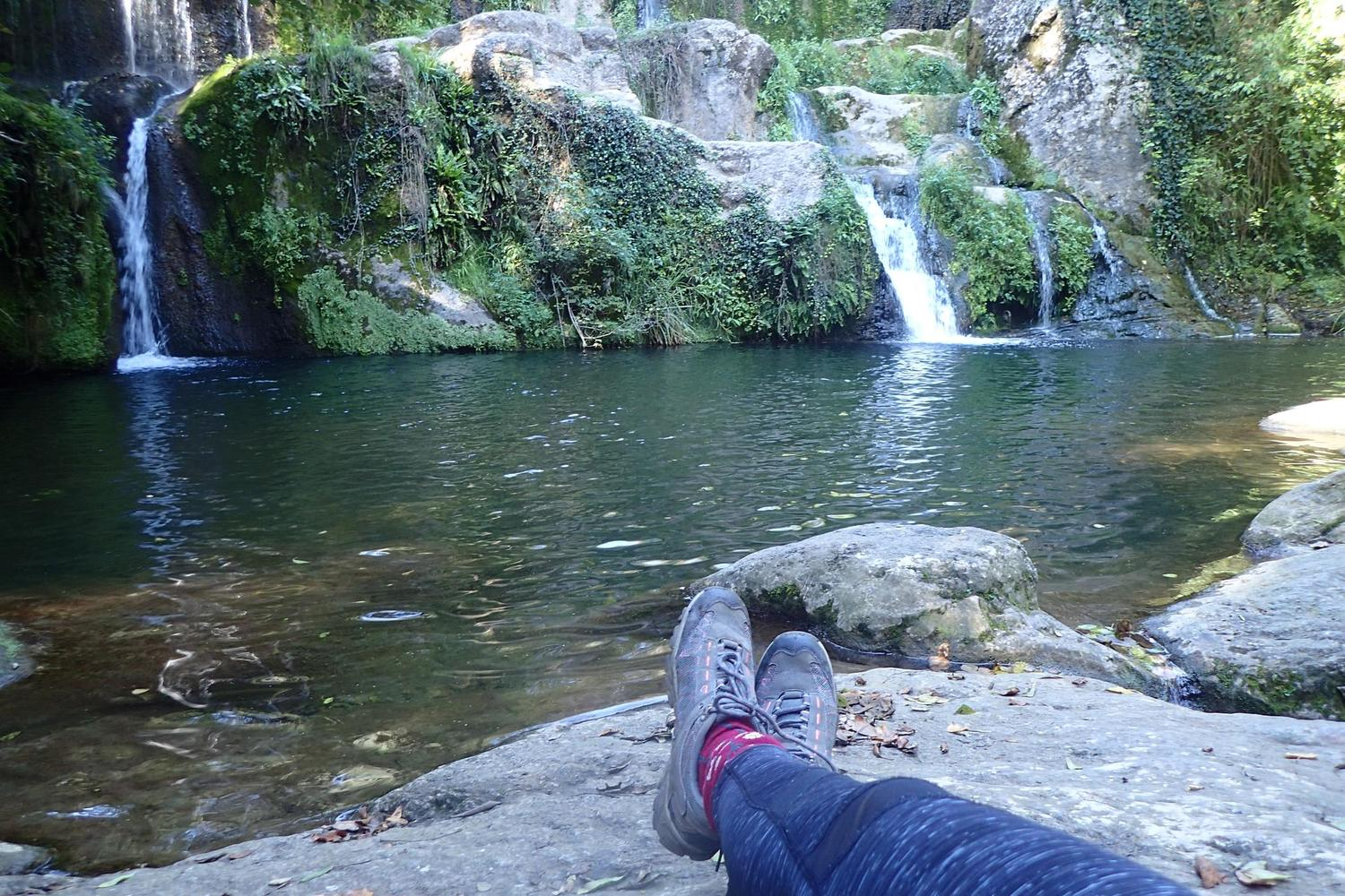 Greta and her boots take a moment to appreciate the Can Batlle Waterfall