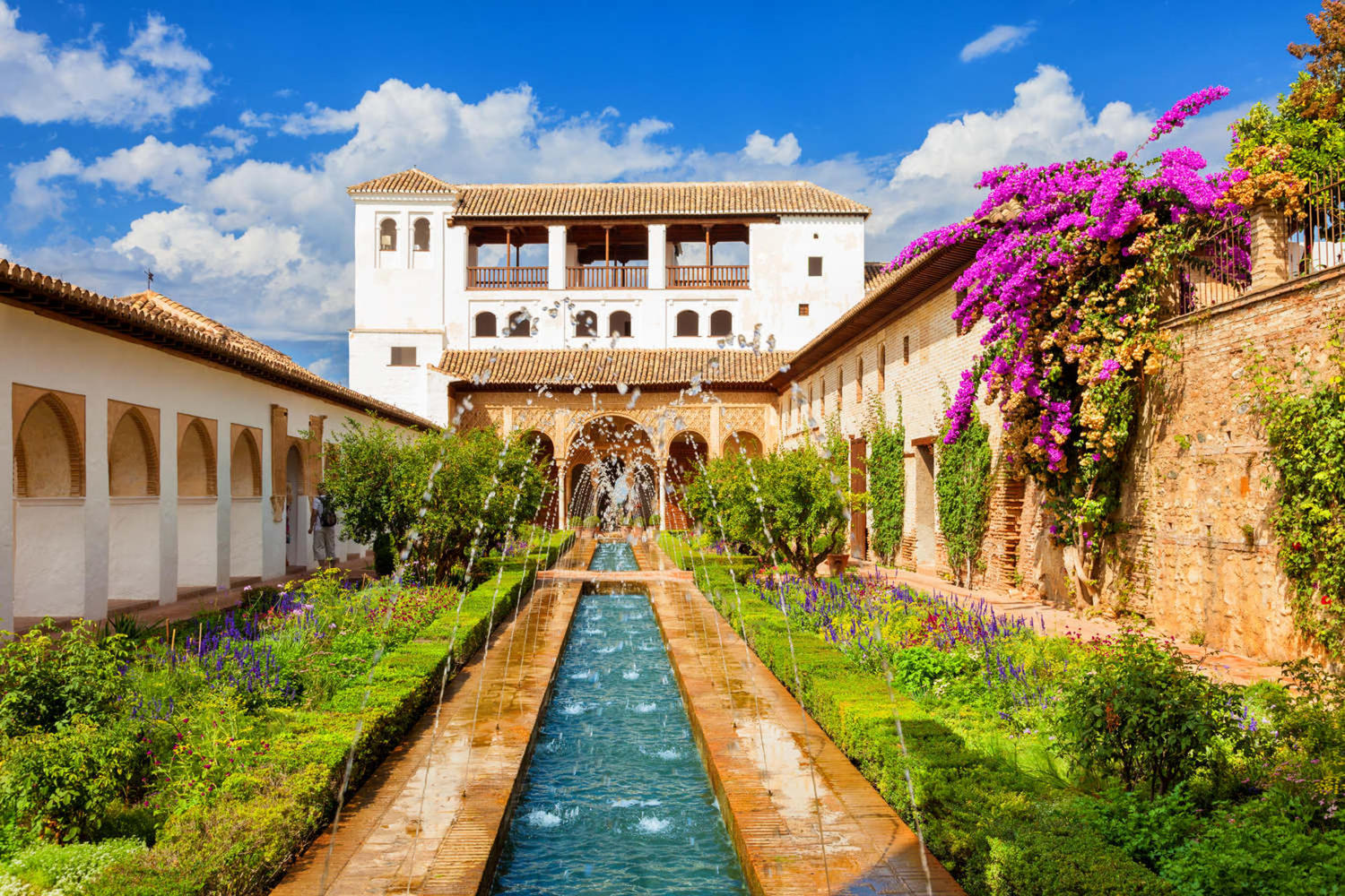 View of the Generalife courtyard with its famous fountain and garden at La Alhambra