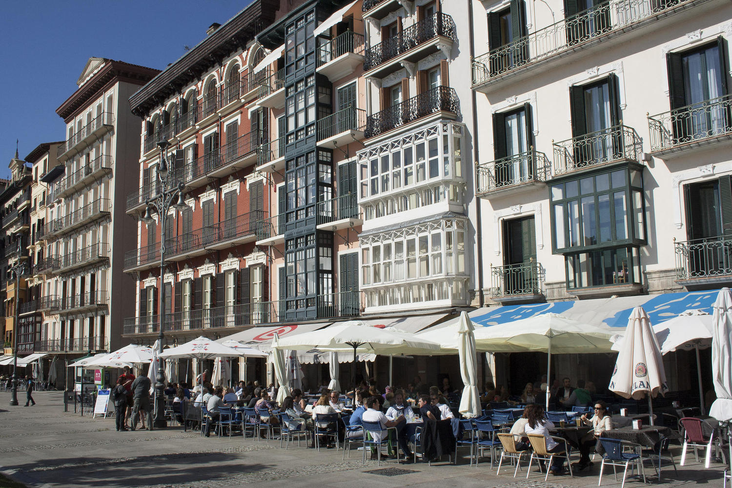 Locals enjoy the sun at Pamplona´s main square.