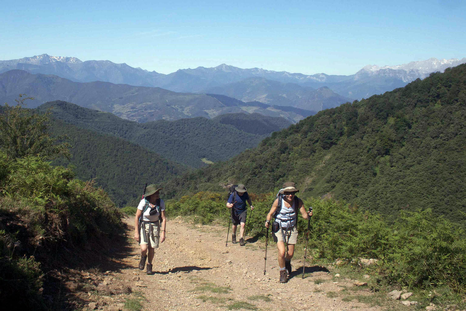 Walking  uphill to a shrine with the Liebana Valley behind