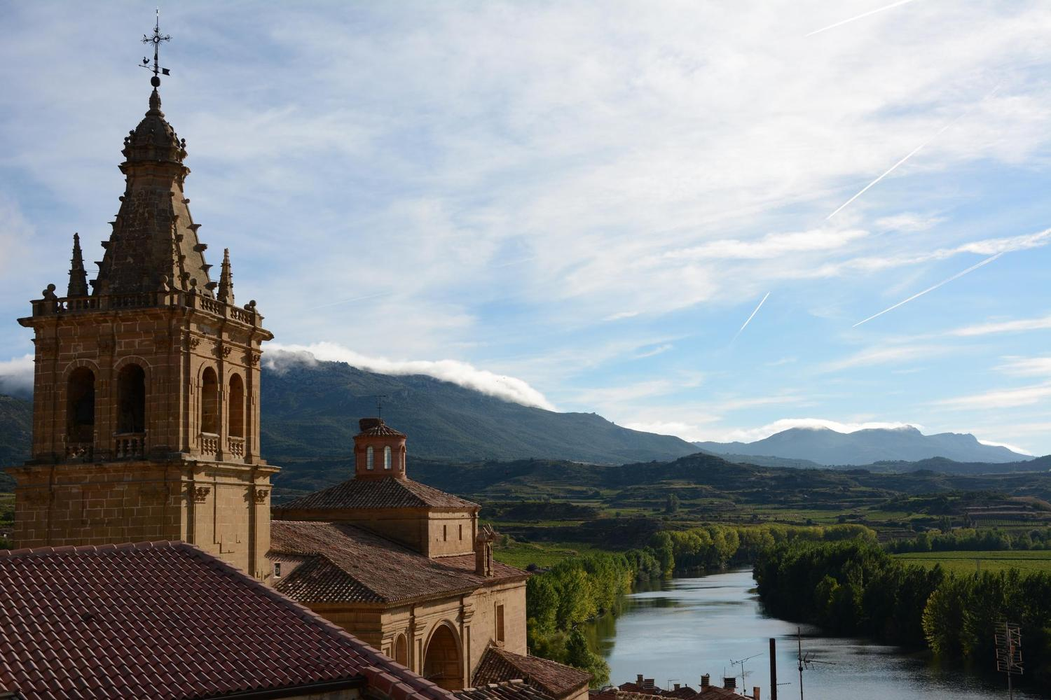 Looking out from the village of Brinas over Rioja's vineyards, the Ebro River and the Cantabrian mountains