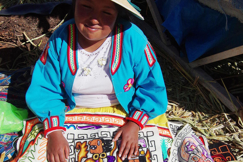 Uros islander selling her weavings on Lake Titicaca
