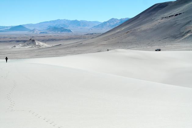 Argentina salta sand dunes puna two people walking towards vehicle