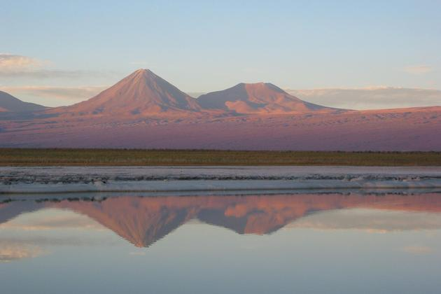 Chile atacama sunset lagoons with volcanoes