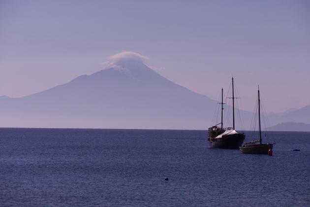 Chile lake district puerto varas lake llanquihue two boats osorno backdrop