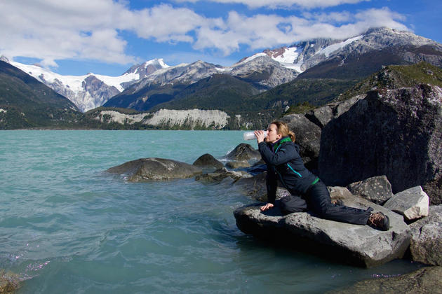 Chile patagonia carretera austral woman drinking from leones lagoon flipped c pura aventura thomas power
