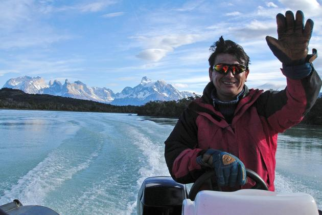 Chile patagonia torres del paine rio serrano zodiac ride waving captain