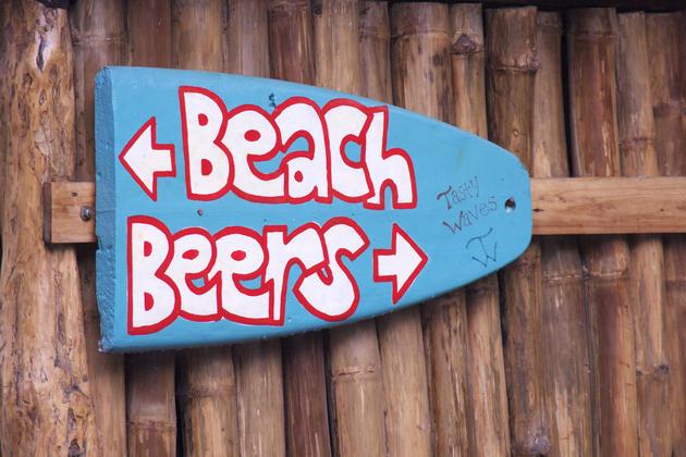 Costa rica caribbean beach beers signpost