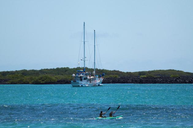 Ecuador galapagos islands sea kayaks behind cachalote yacht20180829 76980 1ta010b
