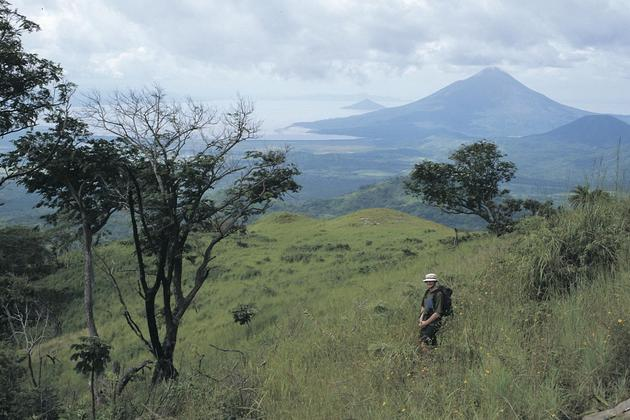 Nicaragua man walking up volcano views