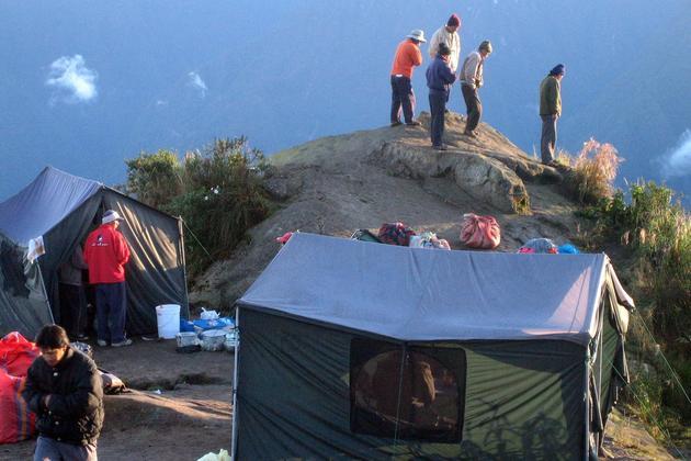 Peru inca trail to machu picchu sunrise at phuyupatamarka campsite