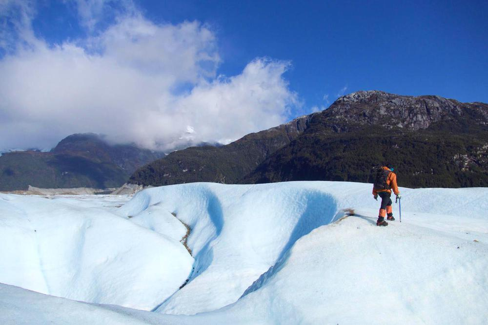 Chile patagonia carretera austral exploradores glacier guide walking onto left hand edge of image 020180829 76980 s3xe4o