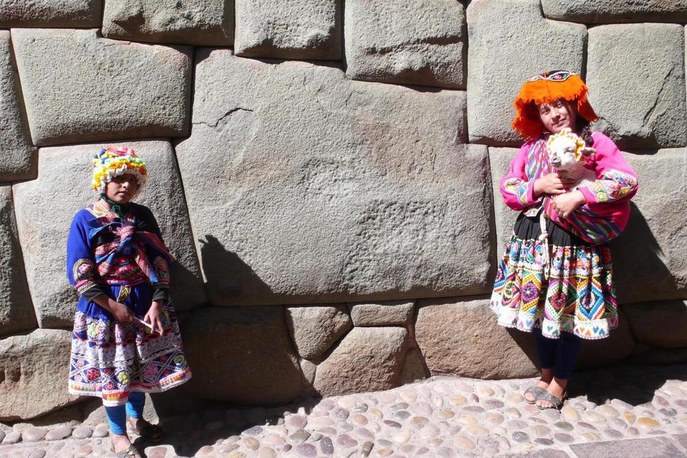 Peru cusco inca girls baby llama 12 sided stone20180829 76980 9g8qio